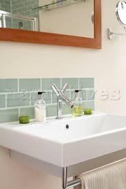 hj012 19 green tiled splashback above sink in london narratives