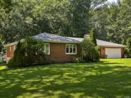 monroe houses for sale include this brick ranch near golf course