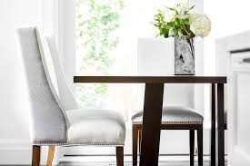 white and gray wingback dining chair transitional dining room