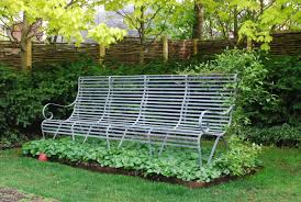 Garden Bench With Trellis by The Clematis On The Bench Dirt Simple
