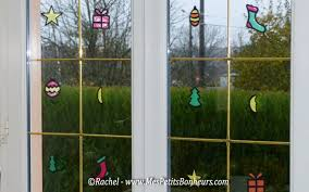Stained Glass Christmas Window Decorations by Diy Christmas Stained Glass Ornaments With Colored Cellophane