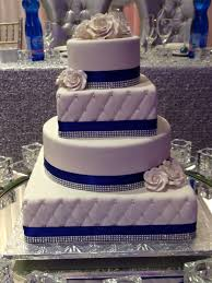 royal blue trimmed 4 tier round and square wedding cake this cake