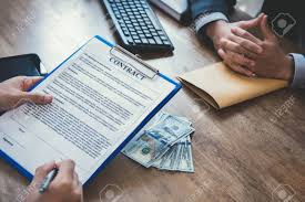 make money under the table business partner making contract with money on the table bribery
