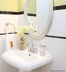 green with decor picking hardware in a bathroom renovation