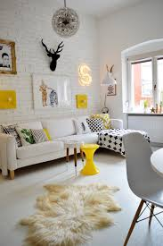 Yellow Round Area Rugs Living Room Pendant Chandelier Exposed White Brick Wall Armchair