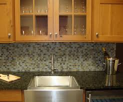 kitchen black countertop white marble backsplash tile kitchen