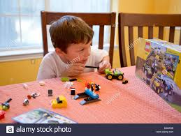 How To Put A Box Together 7 Year Old Mexican American Boy Plays Builds And Looks At Box To