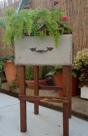sold repurposed old desk drawer into vintage style plant stand
