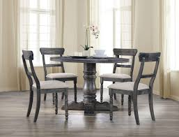 4 chair dining table grosvenor round walnut table with four brown
