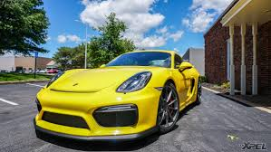 porsche yellow bird 2016 porsche cayman gt4 fully wrapped with xpel ultimate
