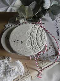 make imprints on air dry clay with a piece of lace or doily 33