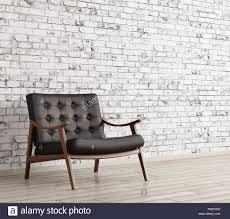 Black Leather Armchairs Interior With Black Leather Armchair Against Of White Brick Wall