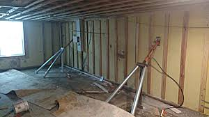 repairing bowed and tilted basement walls in topeka and lawrence area