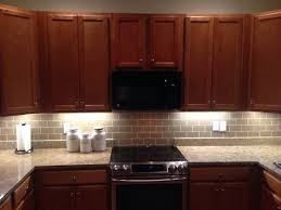 interior champagne glass subway tile kitchen backsplash with