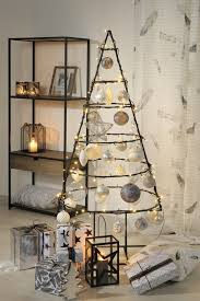 metal christmas tree 15 eye catchy and bold industrial christmas trees shelterness