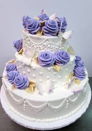 elegant five tier rolled fondant cake with orchids european