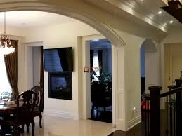 room in a house archways casement millwork headers columns accent haus