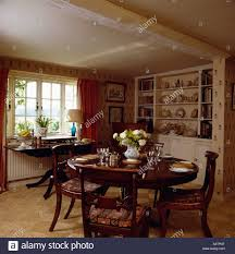 antique table and chairs in small cottage dining room with sisal