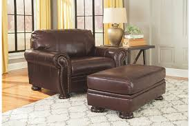 Brown Leather Chair With Ottoman Banner Ottoman Ashley Furniture Homestore