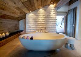 rustic modern loft bathroom with oval stand alone tub under slope