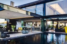 frameless glass stacking doors house by nico van der meulen architects