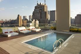 best nyc hotels with pools for a relaxing poolside with cocktails