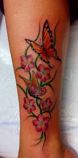 3d butterfly and flower thigh tattoos design idea