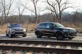 Bmw X5 Specifications - electric or diesel bmw x5 xdrive40e vs range rover sport td6