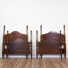 these antique twin beds are featured in a solid wood with a