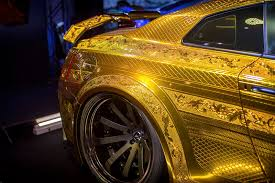 nissan gold this embossed gold nissan gt r is all sorts of crazy autoguide