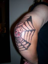 skull with spider web tattoo on elbow tattoos book 65 000