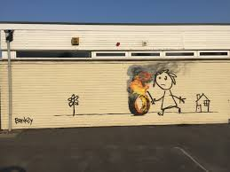 banksy surprises primary school students with mural cnn style