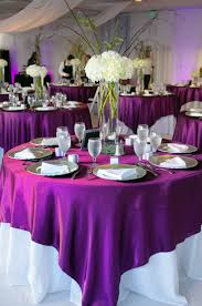 purple and white wedding white tablecloth with purple overlay one of my options use our