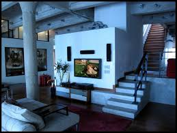 living room industrial ceilings and tv wall unit with area rug