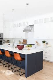 pictures of white kitchen cabinets with island 25 contrasting kitchen island ideas for a statement digsdigs