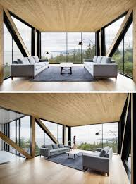 the living room in this home is inside a box that hangs off the