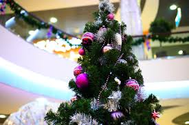 the benefits of holiday decorations for your business shopping mall interior decorated with christmas tree
