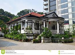 traditional colonial house singapore next to modern highrise