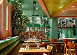 quirky chic amsterdam restaurant brings elements of rainforest