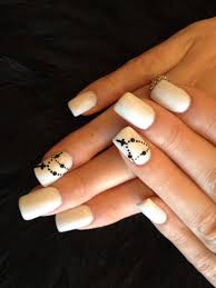 simple acrylic nail art design with black chain cross claws