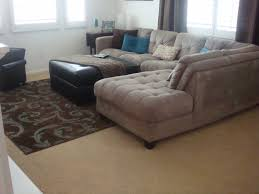 Mocha Ottoman Mocha Fabric Sofa And Square Black Leather Ottoman On Brown Blue