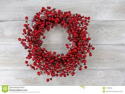 Holiday Wreath Red Berry Holiday Wreath On Rustic White Wooden Boards Stock Photo
