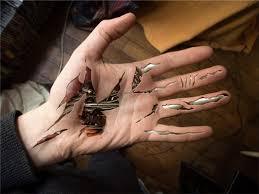 biomechanical ripped skin sleeve tattoos