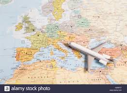 Travel Map Of Europe by Miniature Of A Passenger Airplane Flying Over The Map Of Europe