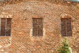 an old brick wall with wood slat windows stock photo picture and