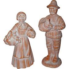 pair of ceramic bisque terra cotta pilgrim figurines sold on ruby