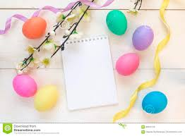 wooden easter eggs that open easter eggs with open blank notepad and apple tree branch on whi