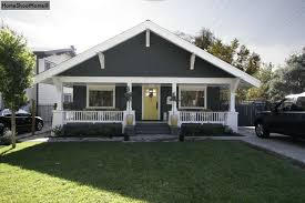gray craftsman bungalow with white trim needs at least one more