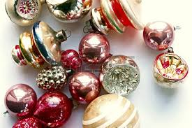 multi colored vintage ornaments on silver platter copy space stock
