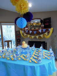 rubber ducky themed baby shower serve yellow or orange drinks with blue punch like bath